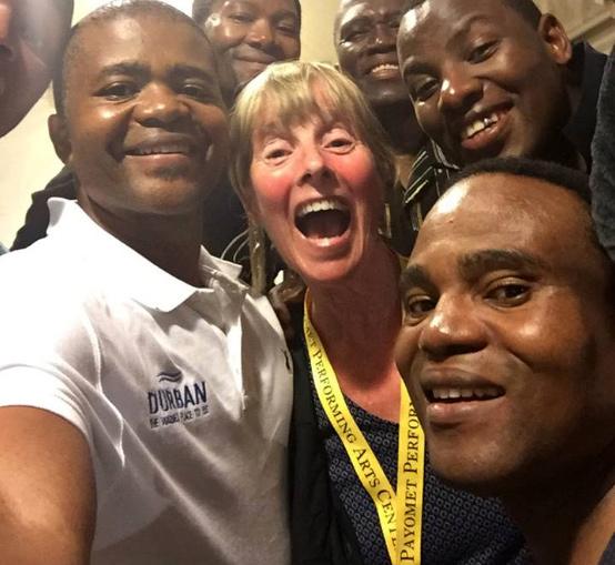 Ladysmith Black Mambazo with one very happy volunteer, Maura Staker!!